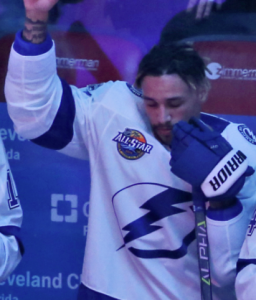 Tampa Bay Lightning forward JT Brown raised his fist during the national anthem…