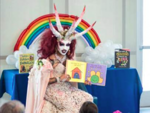 Satanic Looking Drag Queen with Horns Reads to Little Kids at Michelle Obama Public Library in Long Beach…