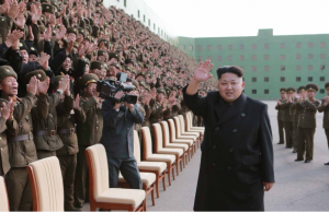 "Theater of War: Kim Jong-Un ""The Rocket Man"" pictured with gigantic missile…"