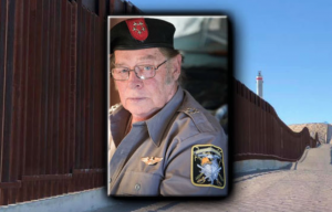 FBI arrests member of militia, Larry Mitchell Hopkins, 69, accused of detaining migrants.