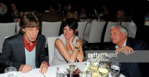 Alleged Jeffrey Epstein child sex procurer, Ghislaine Maxwell, pictured with Mick Jagger in 2011.