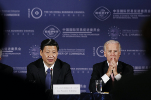 Biden recalls telling China's Xi Jinping the US is about 'possibilities' before swearing in appointees.